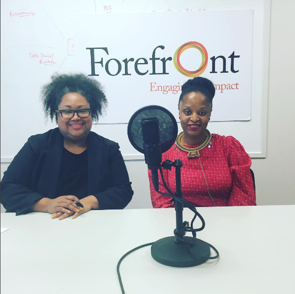 Ayesha Jaco and Delia Coleman seated in front of Forefront Logo