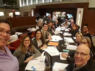 Selfie of Forefront staff and Illinois foundation leaders at FOTH during a table discussion.
