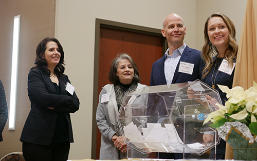 From left: Forefront COO Dawn Melchiorre, Dunham Fund Board Member Wendy Hirsch, Forefront CEO Eric Weinheimer, and Dunham Fund Program Director Lindsay Cochrane draw raffle prizes at the 2019 Fox Valley #ILGive celebration.